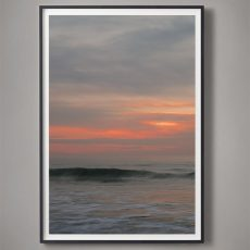 large sunset over ocean photograph